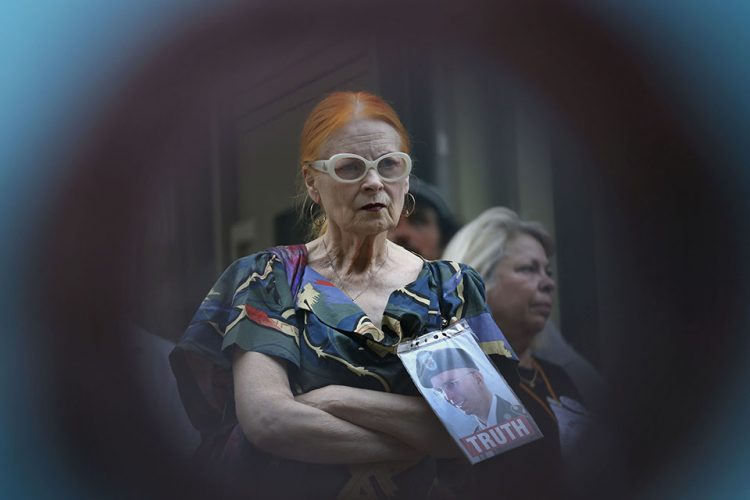 Supporter of U.S. army Pte Bradley Manning, fashion designer Vivienne Westwood listens to a speech by a protester outside the U.S. Embassy in London.