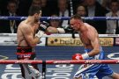 Carl Froch of Britain, left, fights against Mikkel Kessler of Denmark during their super middleweight world title unification boxing match at O2 Arena in London.
