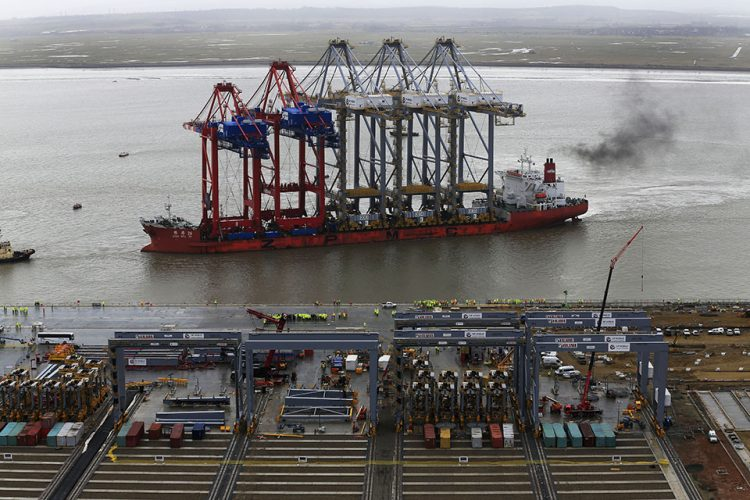 A ship carrying the UK's three largest quay cranes, right three, arrives to deliver to London Gateway deep-water container port on the River Thames inÊStanford-le-Hope, England.