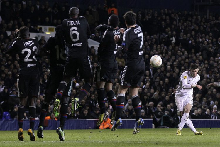 Tottenham Hotspur's Gareth Bale, right, scores against Lyon during their Europa League round of 32 first leg soccer match at White Hart Lane, London
