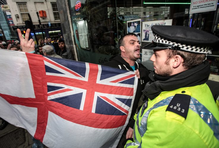 Member of a far right group confront a march organised by the Shariah Project, Brick Lane