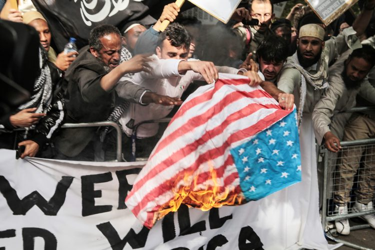 Protestors burn the US Flag outside the US embassy, Grosvenor Square