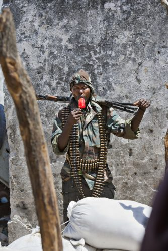 Somali fighter presents abstract image of himself amongst the chaos of war in Mogadishu