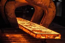 Red hot heavy steel bar from the furnace at British Steel in Teesside
