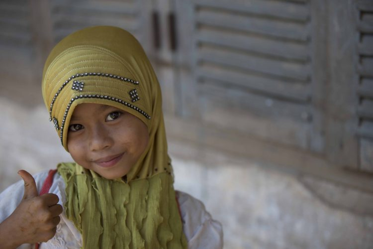 Cambodia, Mekong Delta, a young Cham girl, attends a UNICEF school for Khymer Islam children.