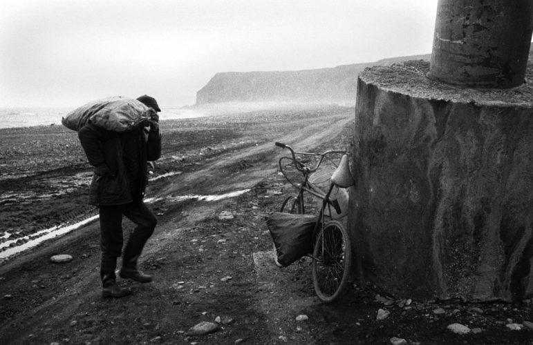 Man collecting coal on Easington beach 1988.