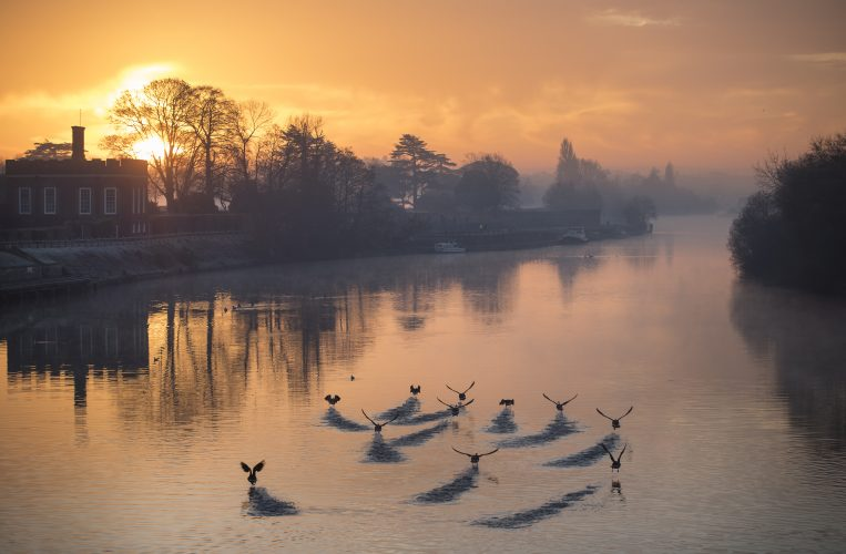 Sunrise on the River Thames by Hampton Court Palace at first light. December 28, 2016.