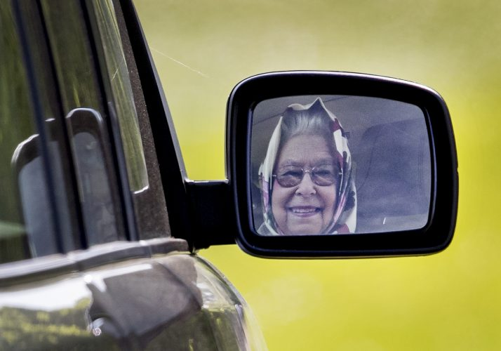 Queen Elizabeth II is reflected in the door mirror of her Range Rover as she drives herself from the Royal Windsor Horse Show. May 10, 2017.
