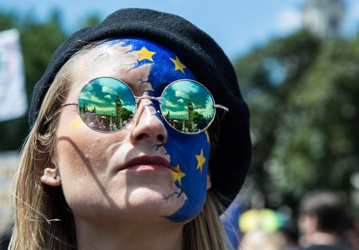 The Houses of Parliament are reflected in the sunglasses of a protester during an Anti-Brexit demonstration