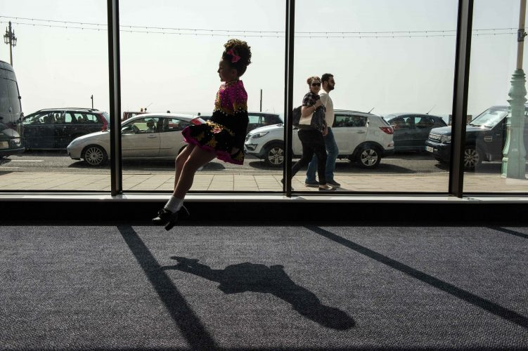 12 year old Irish dancer practices in the lobby before taking to stage in the World Championships
