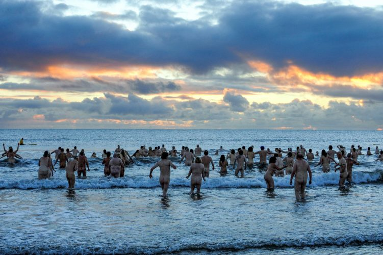 A skinny dipping world record is attempted during sun rise at Druridge Bay, Northumberlanc