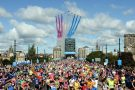 Red Arrows fly by Newcastle as Mo Farah runs to victory in the 2014 Great North Run
