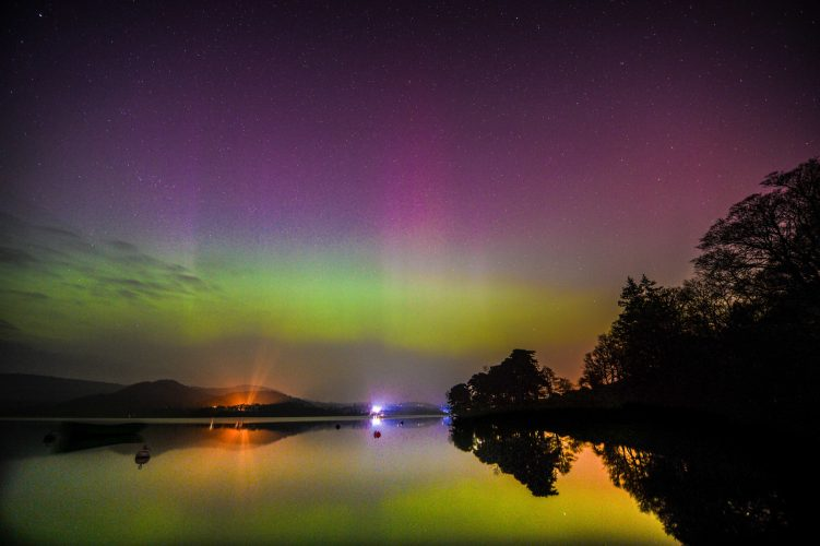 The aurora borealis glows green and pink about Ullswater in the Lake District in a spectacular display in 2015