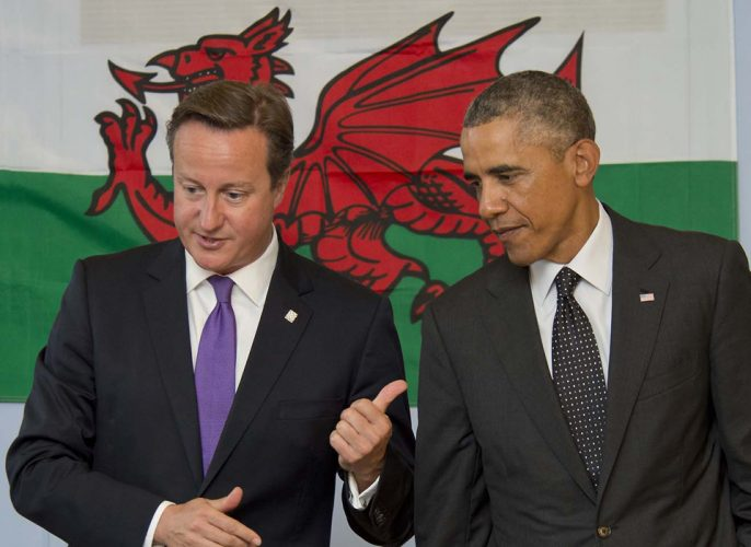 US President Barack Obama and Prime Minister David Cameron visiting a school  prior to the Nato conference in Newport, Wales.