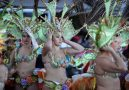 Dancers adjust their headwear before the main Mardi Gras parade in Santa Cruz, Tenerife