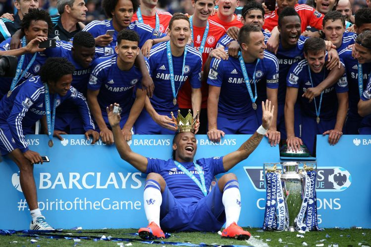 Chelsea players celebrate winning the Premier League.