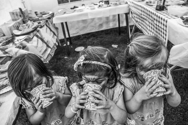 Triplets at a street party  in Crook, County Durham.