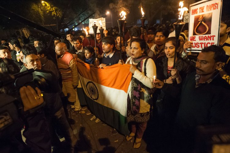 Crowds of demonstrators take part in a night-time vigil at Jantar Mantar, New Delhi. Earlier that day news broke of the death of a victim of gang-rape.