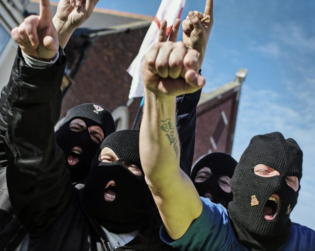 Members of the far right group the North East Infidels march through Hartlepool town centre.