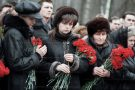 Kursk submarine disaster...Funeral in St.Petersburg…a widow of a kursk sailor at his funeral, 18 months after he was killed. The delay in recovering his body was due to the Russian government concerns over secrets aboard the stricken submarine. For M mag