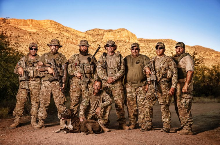 A heavily armed civilian militia patrol the US-Mexico border in Arizona