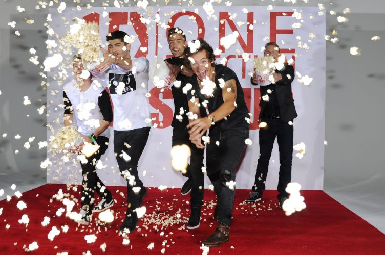 1D throw popcorn at photographers during the 'This is Us 3D' photocall