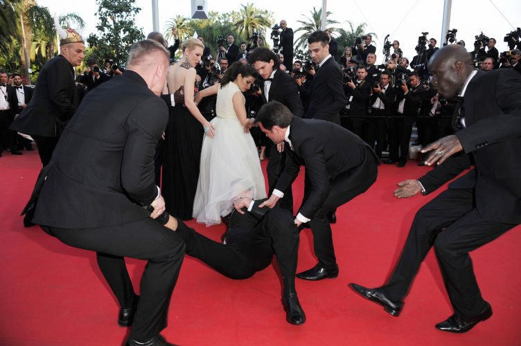 Ukranian prankster/journalist runs onto the Cannes Film Festival Red Carpet during the premiere of 'How to Train Your Dragon 2'