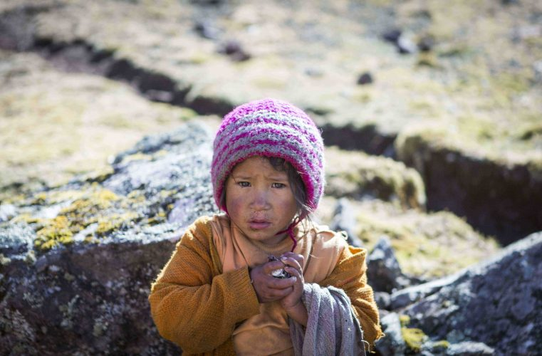 A child in a remote part of the Lares district , Peru