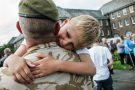 A father greeted by his son as the Scots Guards return to their UK barracks after a tour of Afghanistan.