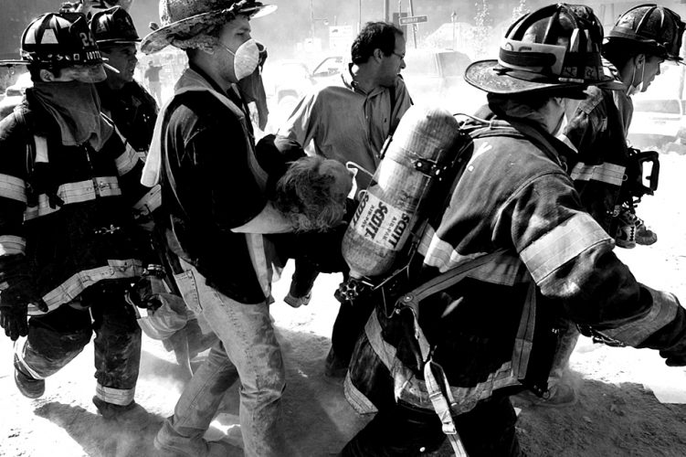 A casualty is rescued from the collapse of the North Tower, September 11, 2001