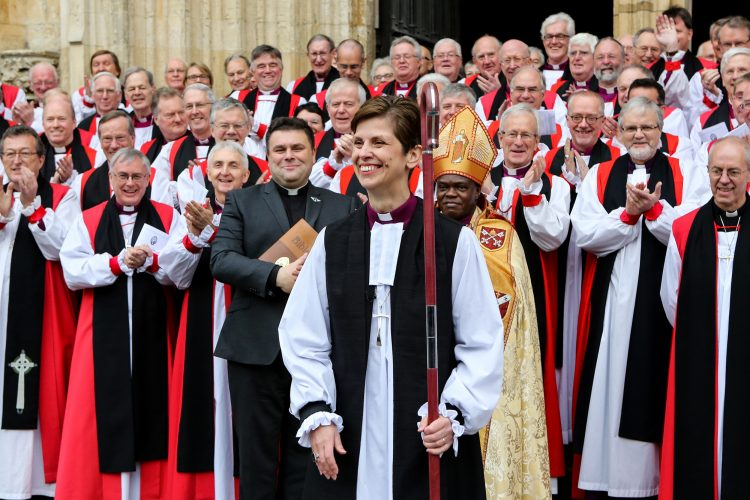 Libby Lane is greeted with a rapturous applause outside York Minster after being consecrated as The Church of England's first female bishop.