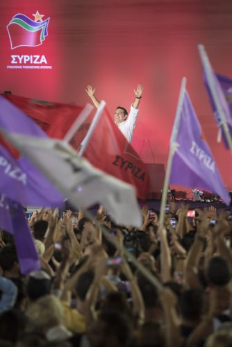 Syntagma Square, Athens, Greece. 18th September, 2015. Several thousand SYRIZA supporters converge on Syntagma Square in the centre of Athens to listen to the party's leader, Alexis Tsipras, before the Greek general elections.